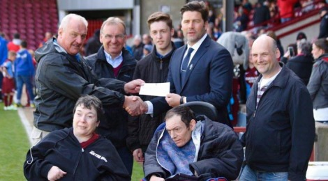 Community Shield donation to Lincolnshire House.